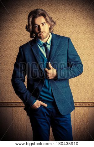 Handsome young man in elegant suit and a tie. Fashion hair styling, barbershop. Business style.