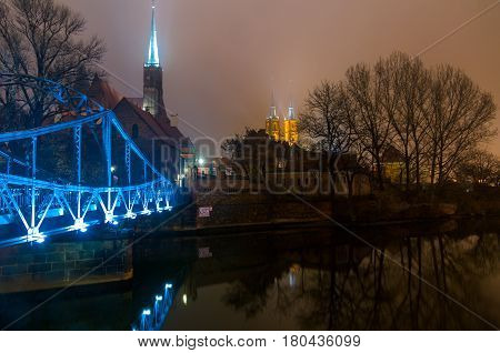The Tumski bridge and Cathedral of St John Baptist at night Wroclaw Breslau Poland