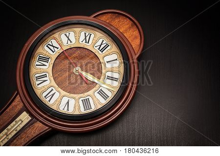 closeup Vintage wall clock in black background
