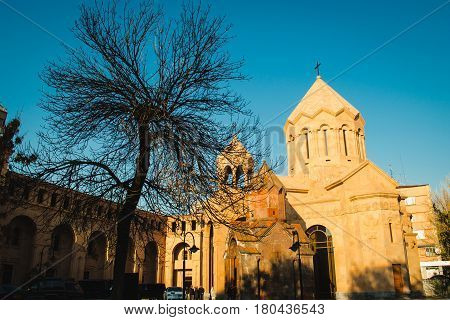 Photo of the Katoghike the oldest surviving church in Yerevan and new religious complex of residence of the Catholicos with Saint Anna Church. Architecture concept. City center. Armenia