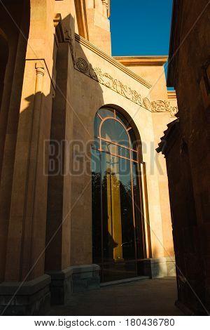 Photo of the Church tall arced window. Saint Anna Church. Armenian architecture. Yerevan City center, Armenia. Religious background. Exterior concept.