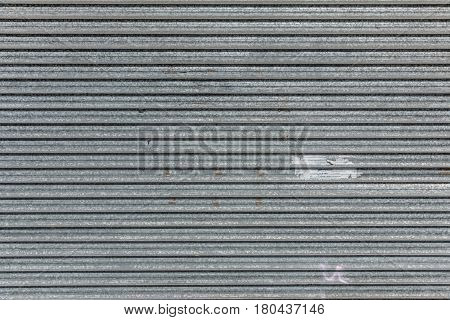 Old metallic roller shutter texture used for security