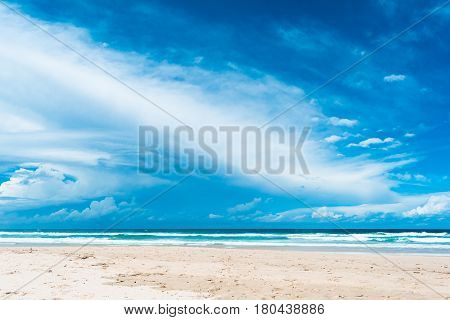 The beutiful view of dark blue sky with white cumulus clouds in hot sunny summer day on the beach in Gold Coast, Australia