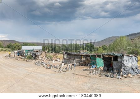 NIEU BETHESDA SOUTH AFRICA - MARCH 21 2017: Curios stalls at the entrance to the Owl House in Nieu-Bethesda an historic village in the Eastern Cape Province