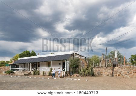 NIEU BETHESDA SOUTH AFRICA - MARCH 21 2017: Unidentified tourists at the Owl House museum in Nieu-Bethesda an historic village in the Eastern Cape Province