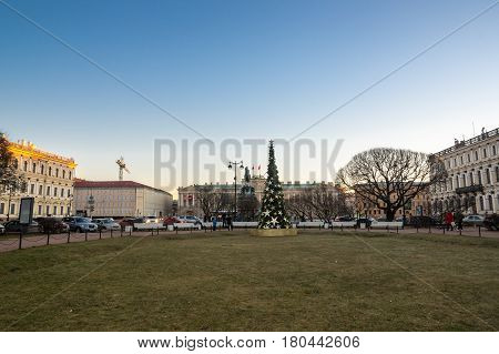 SAINT- PETERSBURG RUSSIA - DECEMBER 27 2015: Saint Isaac's Square or Isaakiyevskaya Ploshchad in Saint Petersburg Russia is a major city square sprawling between the Mariinsky Palace and Saint Isaac's Cathedral