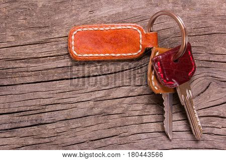 keys and key ring leather on an old wooden table