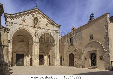View of main facade of Saint Michael Archangel Sanctuary at Monte Sant'Angelo on Italy. Monte Sant'Angelo is a town on the slopes of Gargano promontory (Apulia).