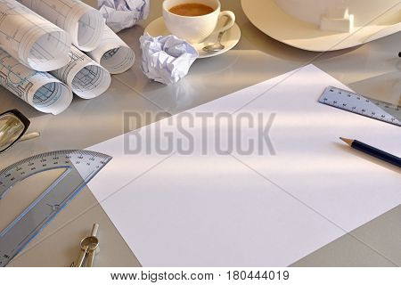Working Table Of Construction Engineer With New Project Elevated