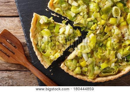 Sliced Savory Pie With Leek And Cheese Close-up. Horizontal Top View