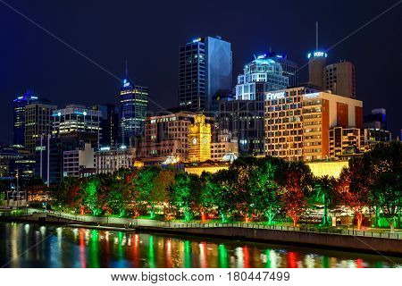 Melbourne Australia - December 27 2016: Illuminated buildings with Railway Station in centre on a night viewed across the Yarra river in Melbourne city