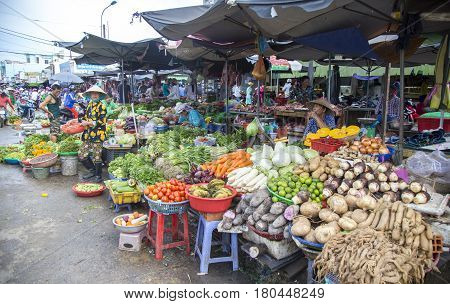 Phu Quoc, Vietnam - Mar 22, 2017: Vietnamese people selling vegetable and fruit at Duong Dong center district market, Phu Quoc island, south Vietnam.