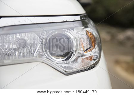Car projector headlight, close up view daylight