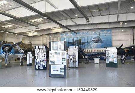 PALM SPRINGS, CA - MARCH 24, 2017: Palm Springs Air Museum, Hangar exhibits with vintage plane at the Palm Springs Air Museum.