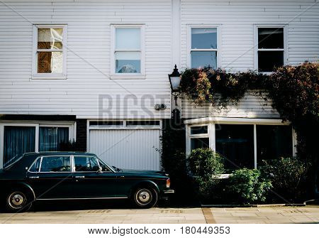 LONDON, UK - FEBRUARY 12, 2016: Old navy green Rolls Royce parked in quiet mews in London.
