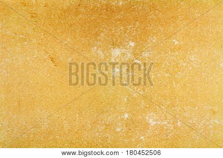 Old brown paper texture with abrasions on the surface. Abstract background