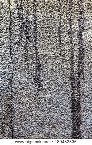 Texture concrete wall with stains of bitumen mastic. Abstract background