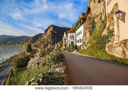 DUERNSTEIN/ AUSTRIA - APRIL 2, 2017. View of residential street and the highway along the Danube river. The town of Duernstein in the Wachau valley, Lower Austria