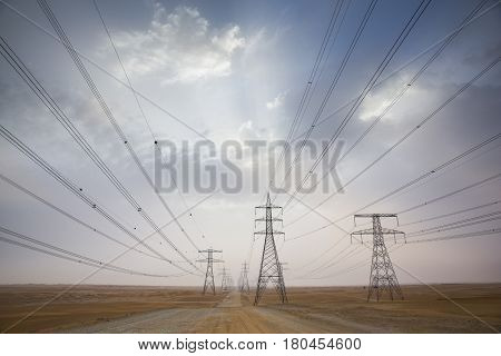 Power Line In A Desert Near Abu Dhabi