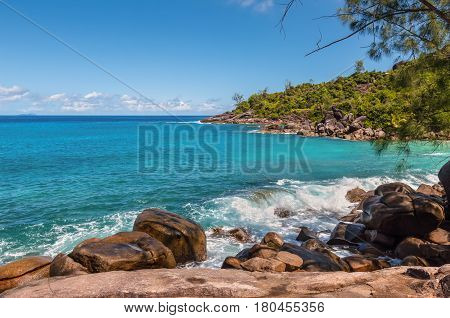 View from Anse Major Nature Trail over the northwest coastline of Mahe island and granite rock in the foreground Seychelles