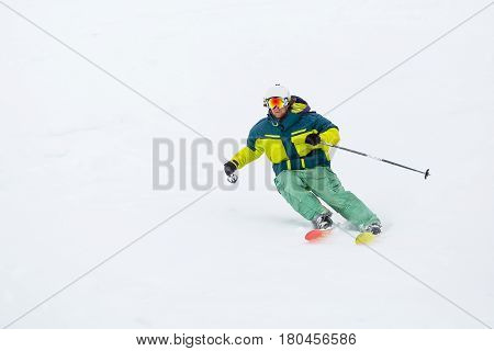 Skier Skiing On Fresh Snow On Ski Slope On Sunny Winter Day In The Ski Resort In Georgia