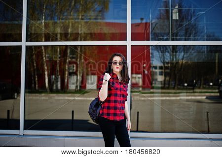 Fashion Portrait Girl With Red Lips Wearing A Red Checkered Shirt And Backpack With Sunglasses Backg