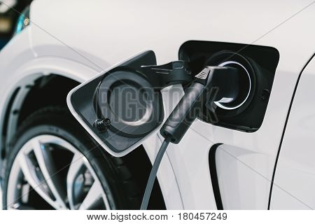 Electric Vehicle charging system. EV fuel for advanced hybrid car. Modern automobile technology or advanced energy concept