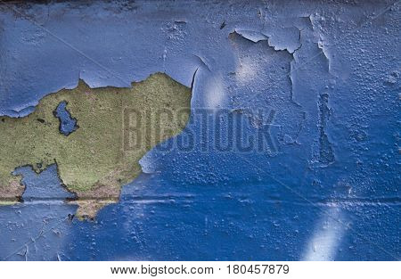 peeling blue paint wall