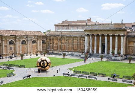 VATICAN CITY ITALY - July 26 2015: Belvedere Courtyard at the Vatican which contains the Sphere Within A Sphere sculpture by Italian sculptor Arnaldo Pomodoro. Different versions of the bronze globe can be found around the world.