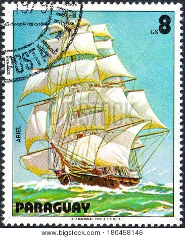 UKRAINE - CIRCA 2017: A postage stamp printed in Paraguai shows Sailing ship Ariel from the series Sailboat painting circa 1979