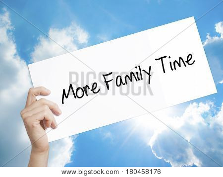 Man Hand Holding Paper With Text More Family Time  . Sign On White Paper. Isolated On Sky Background