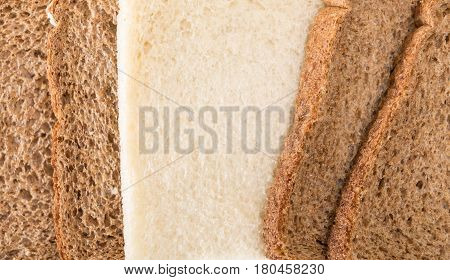 Whole Grain Sandwich Bread Slices With One White Slice Closeup Background.