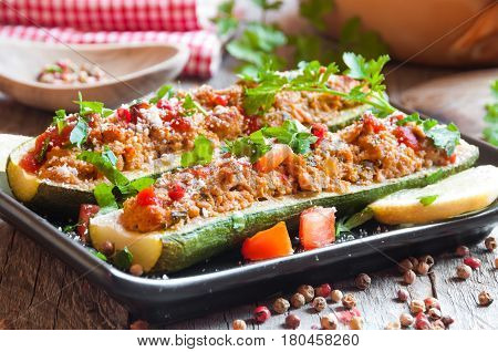 Zucchini cut in halves and stuffed with meat and vegetables
