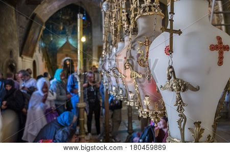 Stone Of Anointing Lamps In Holy Sepulchre Church In Jerusalem. Israel