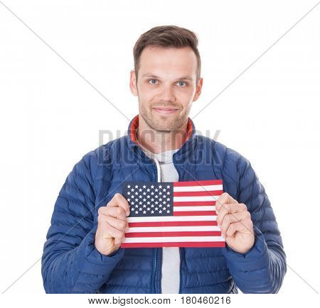 Attractive young man holding US flag. All on white background.
