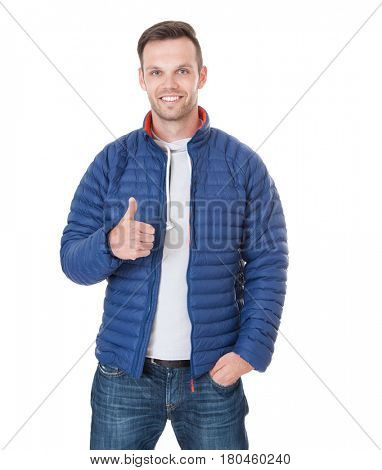 Young man showing thumbs up. All on white background.