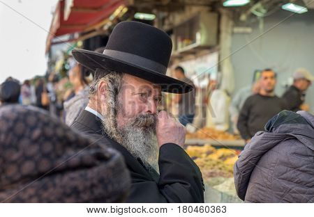 Undefined Orthodox Jewish Man Purchase Meal At Mahane Yehuda Market, Popular Marketplace In Jerusale