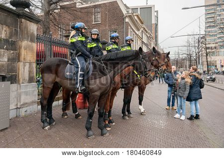 THE HAGUE THE NETHERLANDS - DEC 12 2015: Dutch police officers on horseback in the city of The Hague.