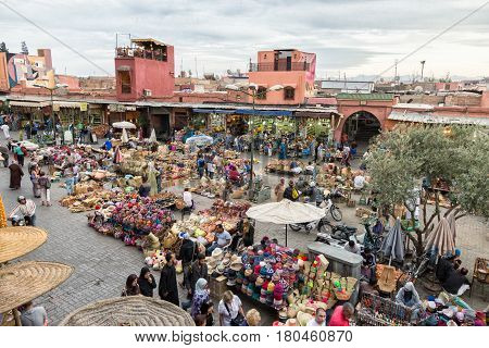 MARRAKECH MOROCCO - APR 28 2016: Tourist visiting a berber market in the souks of Marrakesh.