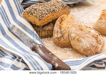 Whole Wheat Sandwich Buns, On Wooden Surface With Flour.
