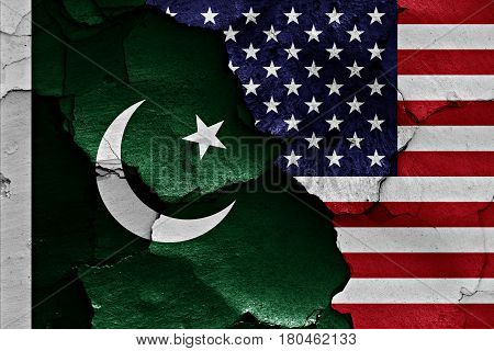 Flags Of Pakistan And Usa Painted On Cracked Wall
