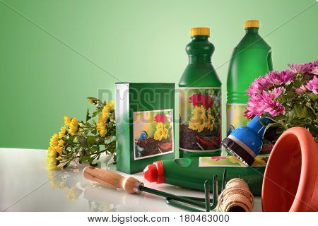 Bottles And Containers Of Gardening Products Composition On White Table