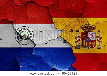 Flags Of Paraguay And Spain Painted On Cracked Wall