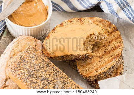 Bitten Whole Wheat Grilled  Bread Slice With Peanut Butter