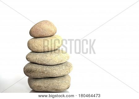 Zen spa stones with blue water and sky. Balanced stones background with copy space. Spa concept. Beautiful picture. Symbol of stability. Stones pile background. Stone balance. Tranquil sustainability