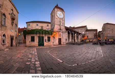 TROGIR CROATIA - SEPTEMBER 28 2015: Saint Sebastian Church and Trg Ivana Pavla II in Trogir Croatia. Trogir was founded in the 3rd century BC by Greek colonists from the island of Vis.
