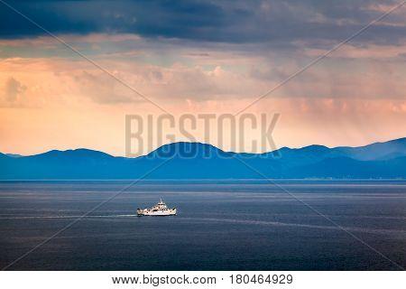 Boat Passing Island of Brac in the Rainy Morning Croatia