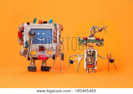 Robots friends ready for service repair. Funny robotic characters with instrument, pliers hand wrenches. Smile message blue screen monitor, cyborg electric wires hairstyle, circuits. Orange background.