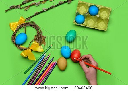 Female Hand With Colorful Painted Easter Eggs With Pencil