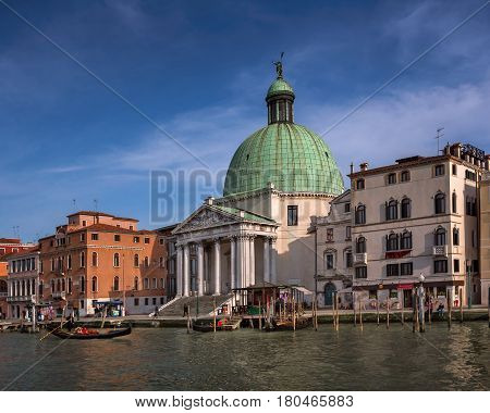 VENICE ITALY - MARCH 10 2014: Chiesa de San Simeone Piccolo and Grand Canal in Venice Italy. Facing the railroad terminal it is a monument widely seen in the city.